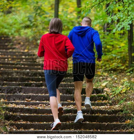 Woman and man running in park