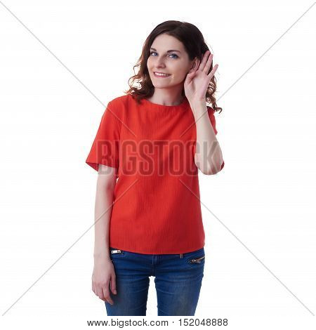 Smiling young woman in casual clothes over white isolated background listening to something, happy people concept