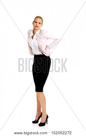 Business woman having huge back pain