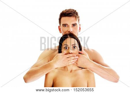 Man covering his girlfriends mouth, isolated.