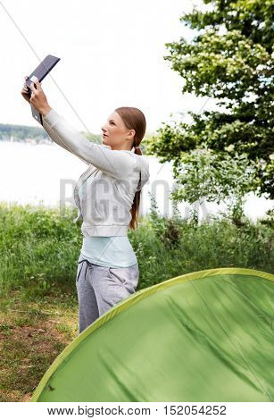 Girl in the tent with tablet