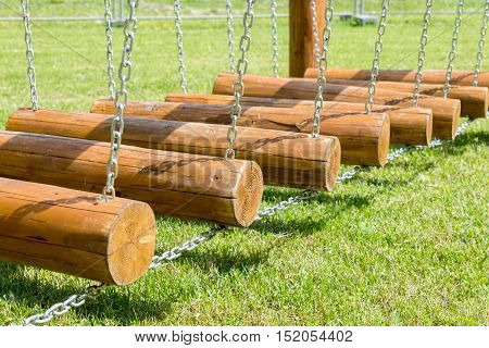 Childrens Bridge Made Of Logs And Chains