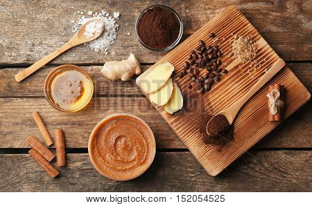 Natural ingredients for homemade scrub on wooden background