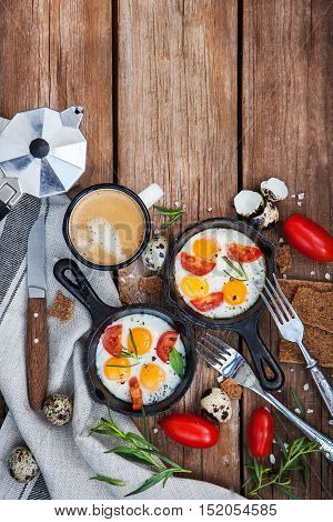 Fried Eggs With Tomatoes In Frying Pans