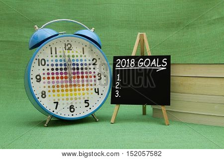 2018 New Year goals written on a small blackboard.
