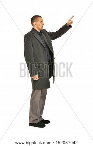Full length shot of an attractive man pointing on white background