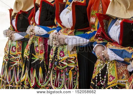 CAGLIARI, ITALY - May 1, 2015: 359 ^ Religious Procession of Sant'Efisio - Sardinia - detail of a female traditional Sardinian costumes