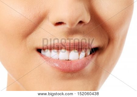 Healthy woman teeth and smile. Isolated over white background