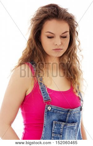 Unhappy and thoughtful young woman
