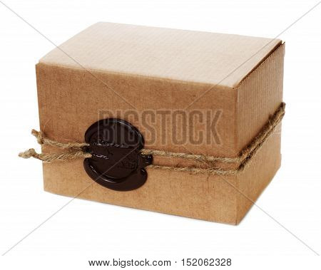 Brown cardboard box with stamp isolated on white background.