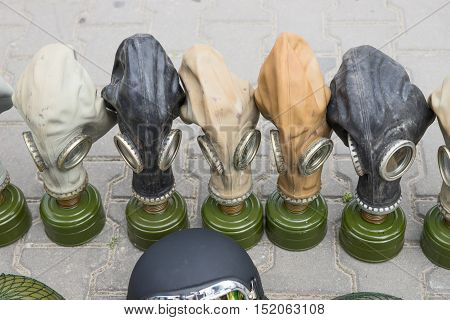 Old gas masks with filter in different colors