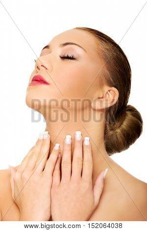 Beautiful spa woman touching her neck.