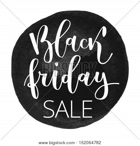 Black friday sale hand written inscription on grunge black round watercolor background