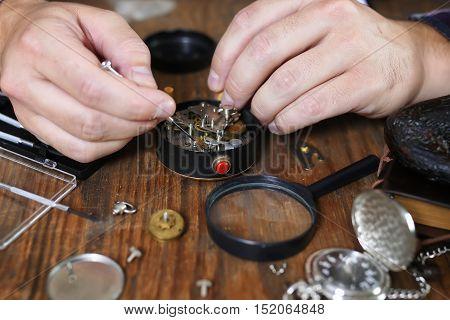 watch clock repairs man working in process