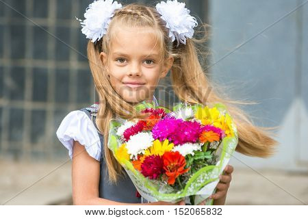 Up Portrait Of First-grader With A Bouquet Of Flowers