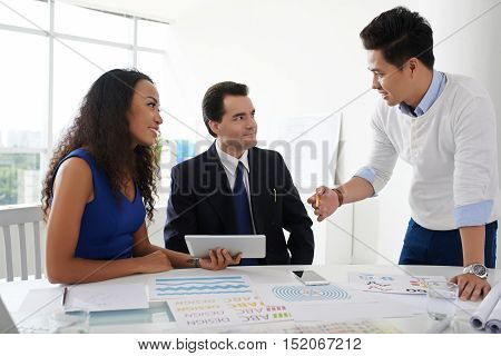 Designer showing his ideas to investors at the meeting
