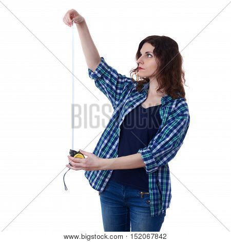 Young woman in casual clothes over white isolated background holding measuring tape, happy people and construction concept