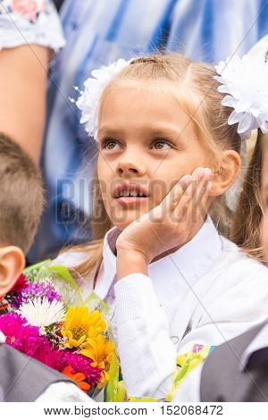 First Grader On The Line Of The First Of September Thinking Looking Up