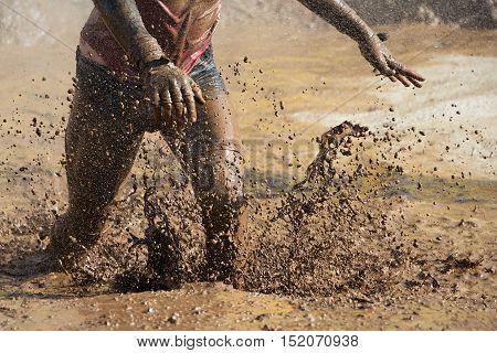 Mud race runners man running in mud