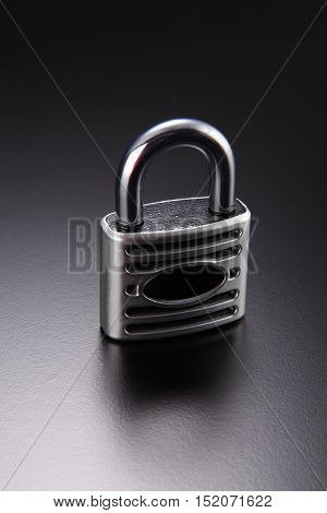 solid padlock on the black background