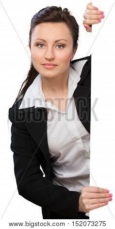 An attarctive woman at a blank white wall