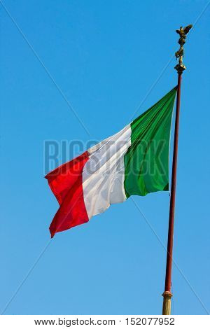 National flag of Italy over clear blue sky