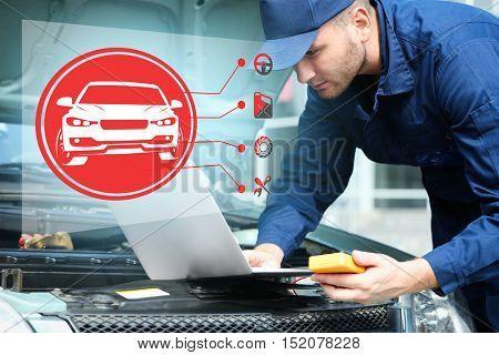 Interface of modern car diagnostic program on workshop background. Car service concept.