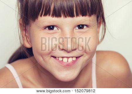 Happy Smiling Girl Wearing Bangs