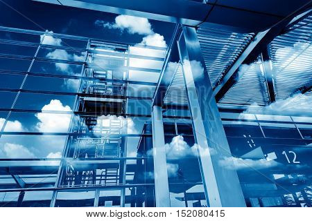 Modern building glass facade and reflection clouds