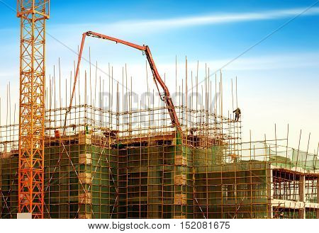 Workers in modern construction sites, scaffolding and cranes.