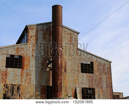 Old Abbandoned Factory With High Chimney