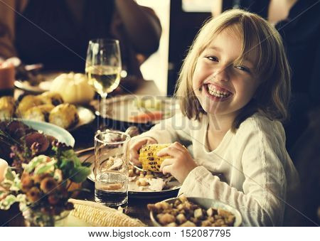 Little Kid Children Eating Corn Thanksgiving Celebration Concept