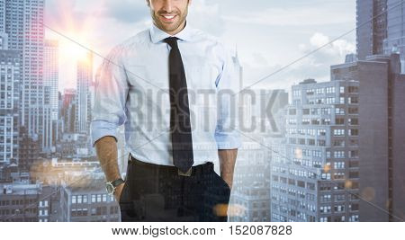 Double exposure image of a modern confident businessman over a city view. Business man with skyscrapers in background during the morning sunlight. Business on the move concept.