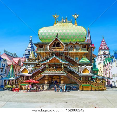MOSCOW RUSSIA - MAY 10 2015: The facade of carved and painted wooden Tsar's Palace in Izmailovsky Kremlin with patterned dome various towers figured porches and double-headed eagles on the weathervanes on May 10 in Moscow.
