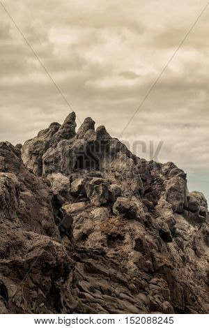 tropical island volcanic cliffs on cloud day