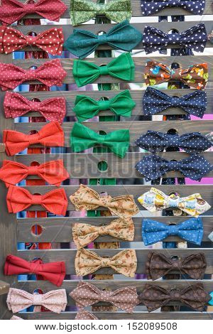 a lot of different colored bow tie, bowtie on wooden deck handmade
