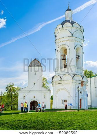 MOSCOW RUSSIA - MAY 10 2015: The tall white bell tower of St George the Vicorious and the Water Tower in Kolomenskoye Manor are the parts of splendid architectural complex on May 10 in Moscow.