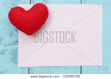 Red heart placed on paper note of empty for input text or message in designconcept of love and Valentine's Day.
