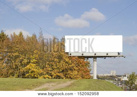 Mock up. Outdoor advertising, blank billboard outdoors, public information board. Autumn city background
