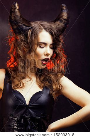 bright mysterious woman with horn hair, halloween celebration close up
