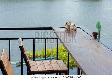 Dining table in the Cozy outdoor cafe. Dining table beside the river cafe.