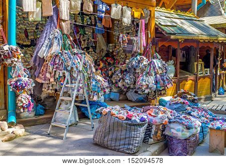The stall in Izmailovsky market offers patterned knit wool socks and mittens traditional Russian souvenirs and essential thing for cold winters Moscow Russia.