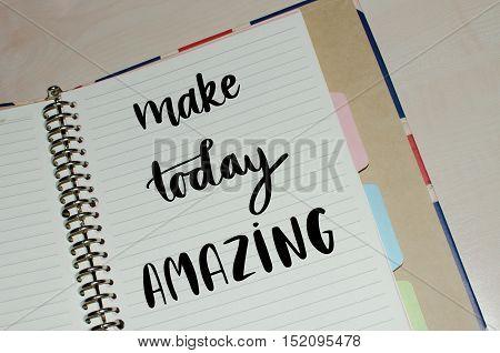 Make today amazing inspirational message written on open agenda