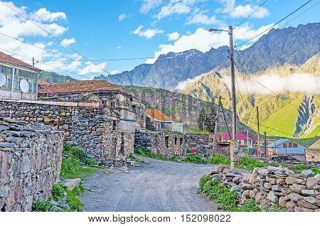 The old neighborhood of Stepantsminda resort located right at the mountain foot and on the consists of the stone houses Kazbegi Georgia.