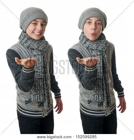 Set of cute teenager boy in gray sweater, hat and scarf holding something over white isolated background, half body