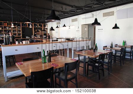 VILNIUS, LITHUANIA - JULY 21, 2015: The modern cafe with cozy interior and with open kitchen, Vilnius, Lithuania.