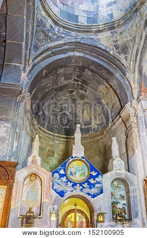 GERGETI GEORGIA - JUNE 3 2016: The interior of Tsminda Sameba (Holy Trinity) Church with old preserved carved decors and renovated icons on June 3 in Gergeti.