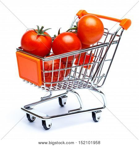 mini shopping cart full with cherry tomatos isolated on white background