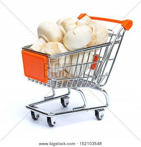 mini shopping cart full with mushrooms isolated on white background