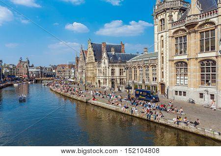 Ghent, Belgium - April 6, 2008:  A Lot Of Students Sitting Along Graslei Street